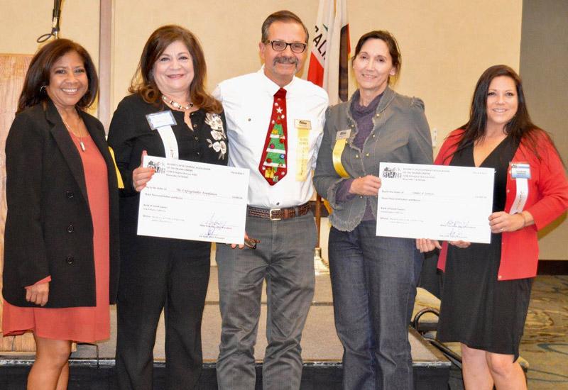 BDA/IE presents two checks to recipients